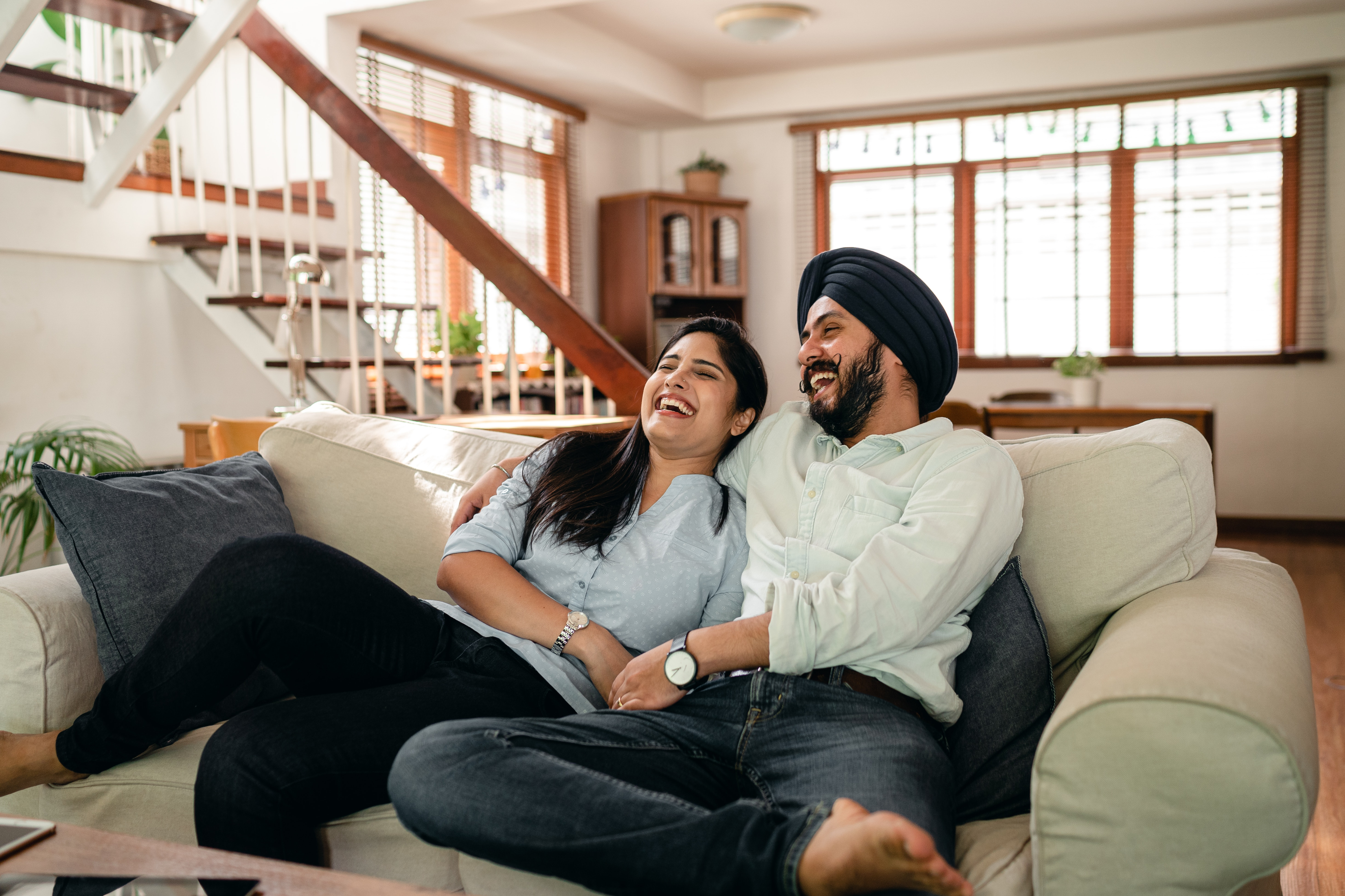 Happy Couple laughing at the living room